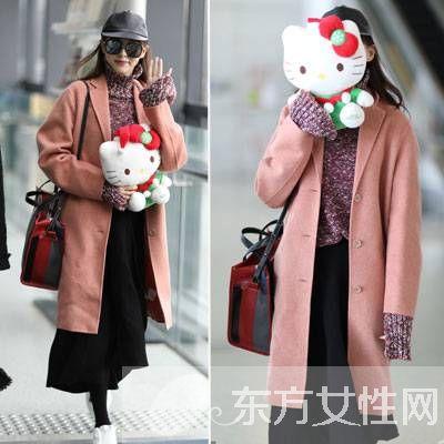 12月19日唐嫣身着呢子大衣