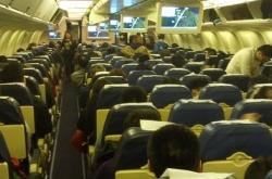 中国乘客救221人 美国飞北京航班遇袭中国乘客出